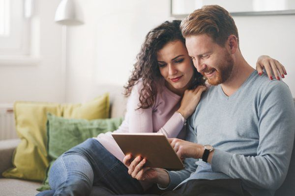 couple sitting with tablet